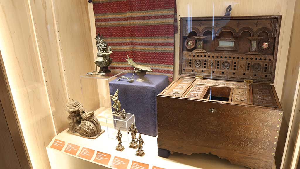 metal sculptures and a large wooden case with many small drawers