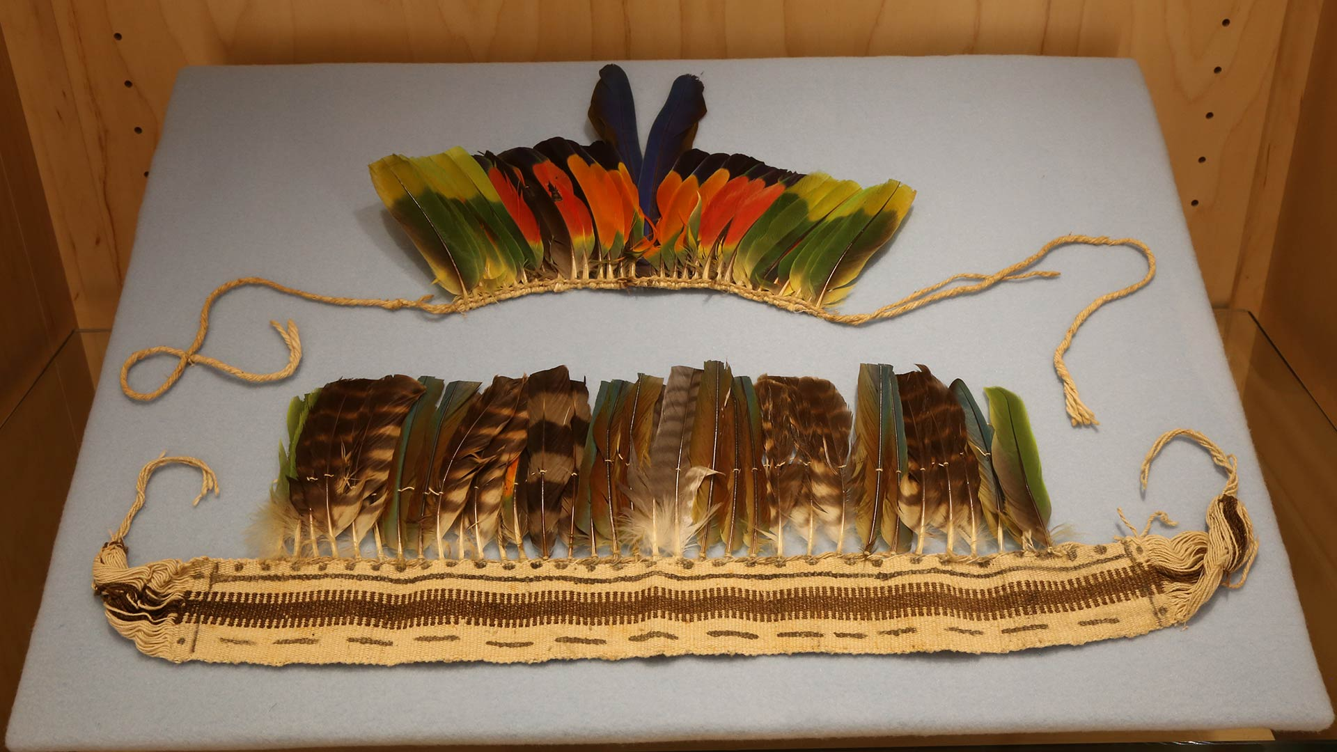 headdress made of woven twine with multicolored feathers attached