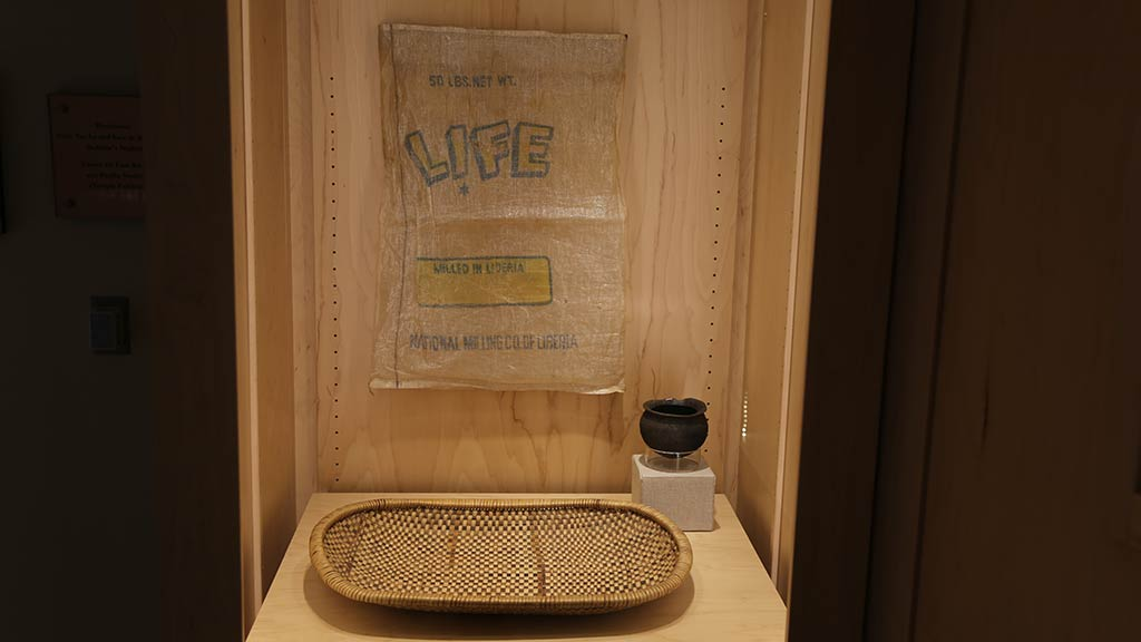 woven tray, a small black pot and a thin sheet with text Life on it