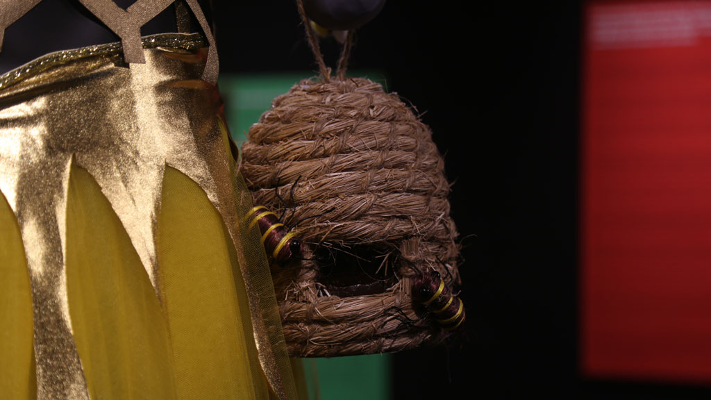 closeup of bag that resembles a bees' nest with bees attached