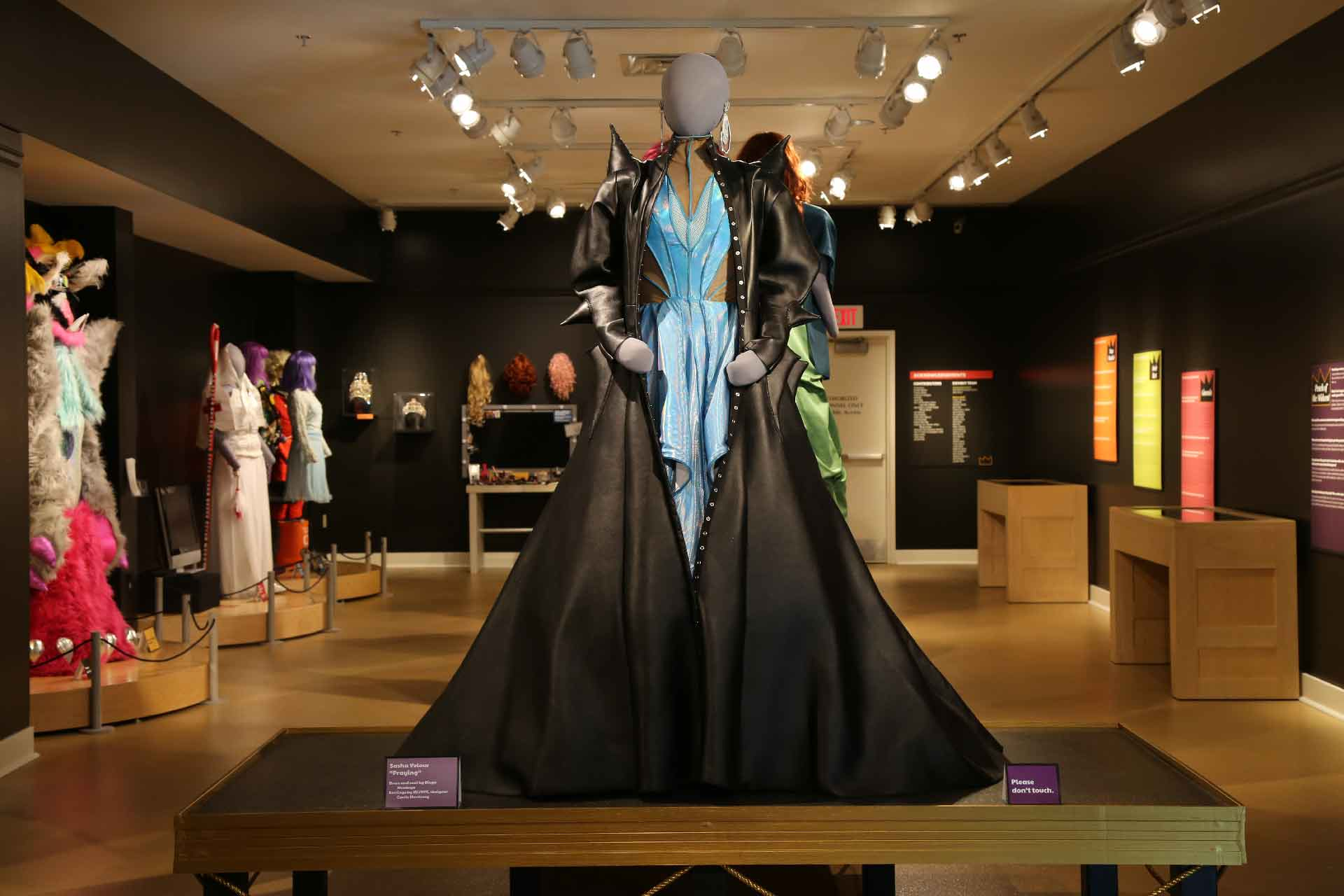 front view of gallery featuring mannequin in light blue and black costume