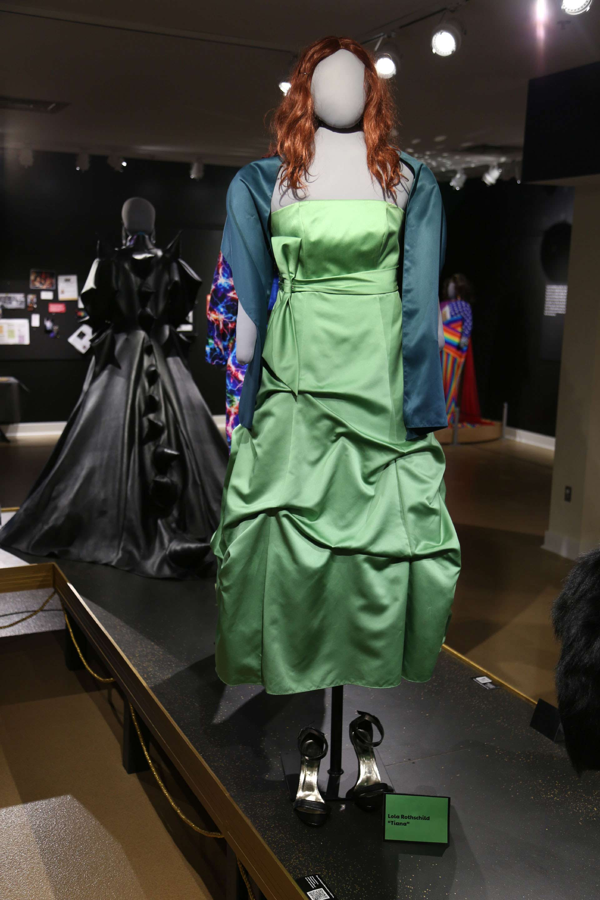 mannequin in long green dress