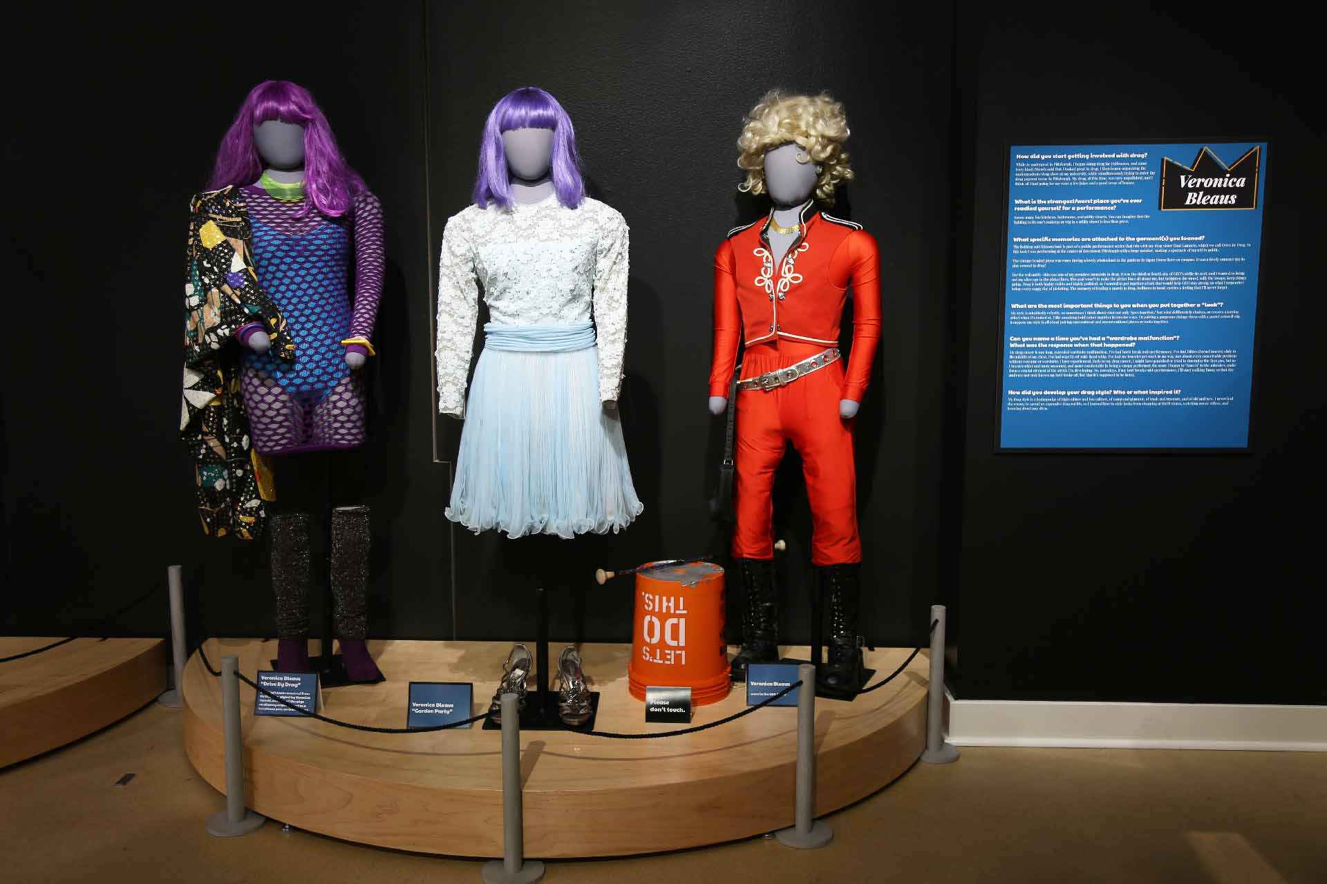 three mannequins in drag on display