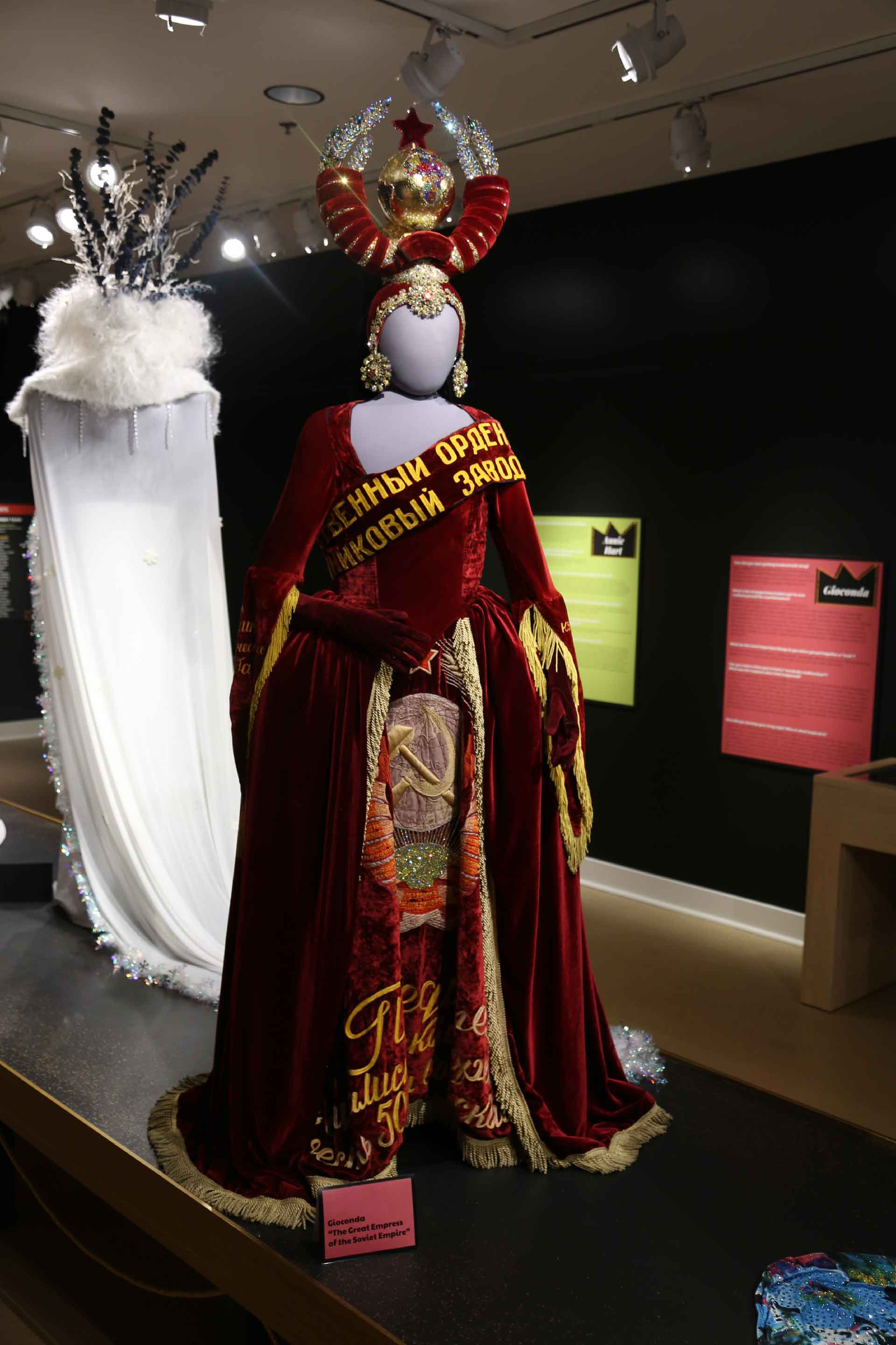 Mannequin in Russian red velvet and gold drag costume
