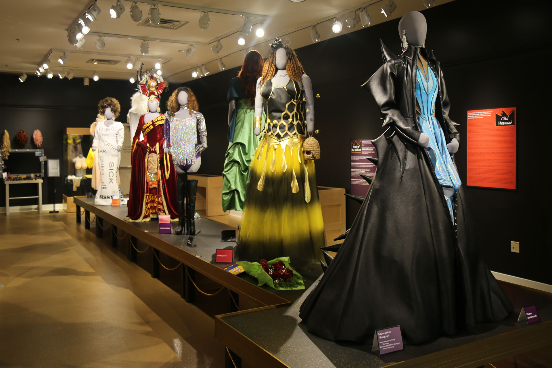 view of runway with several mannequins in elaborate costumes