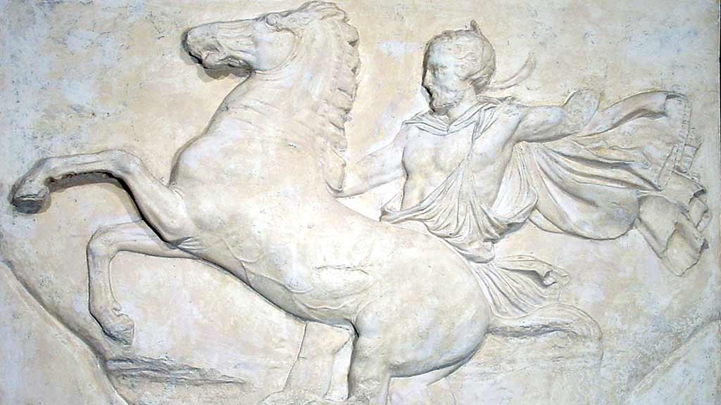 carved wall panel depicting a man riding a horse