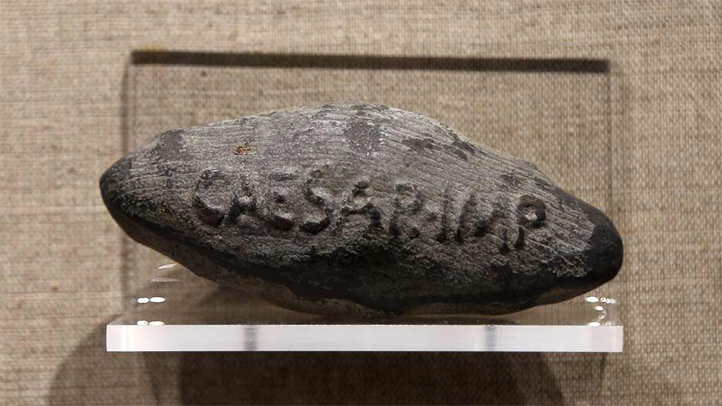 rough diamond shaped bullet that says 'caesar-imp'