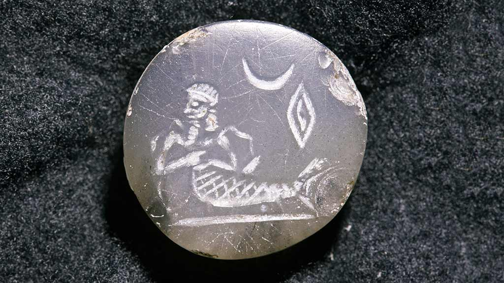 engraved circular seal with fish-man