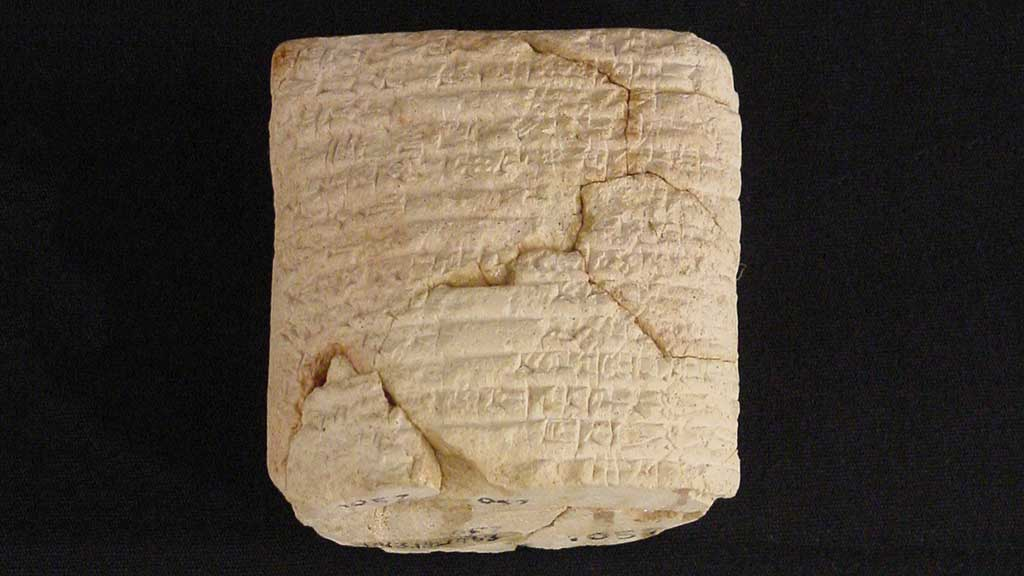 cream-colored cracked square stone with cuneiform