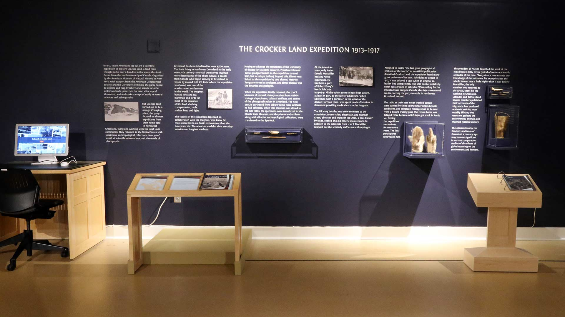 artifacts and photos on the wall aligned with text introduces crocker land expedition