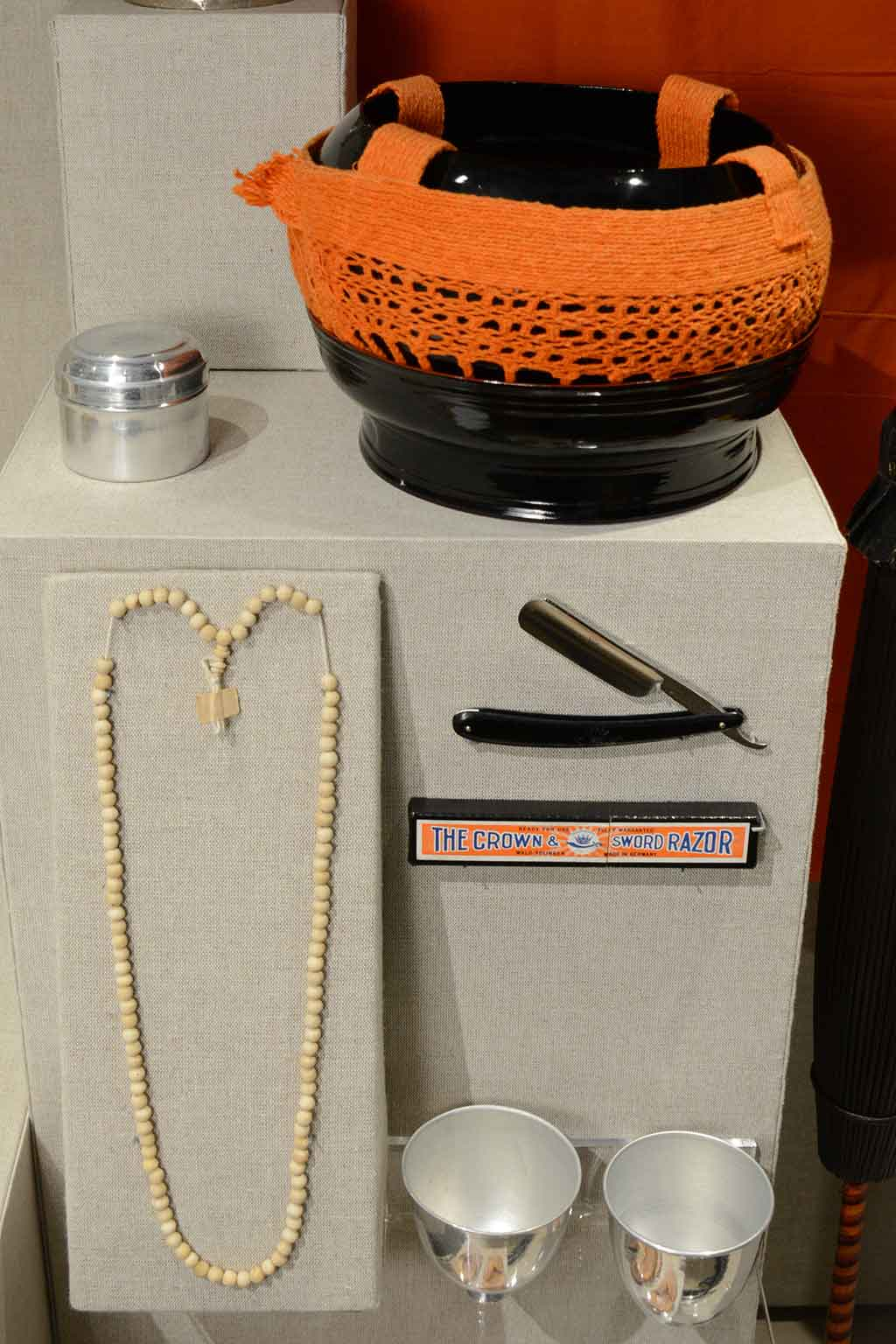 beads, a razor, and various containers on exhibit