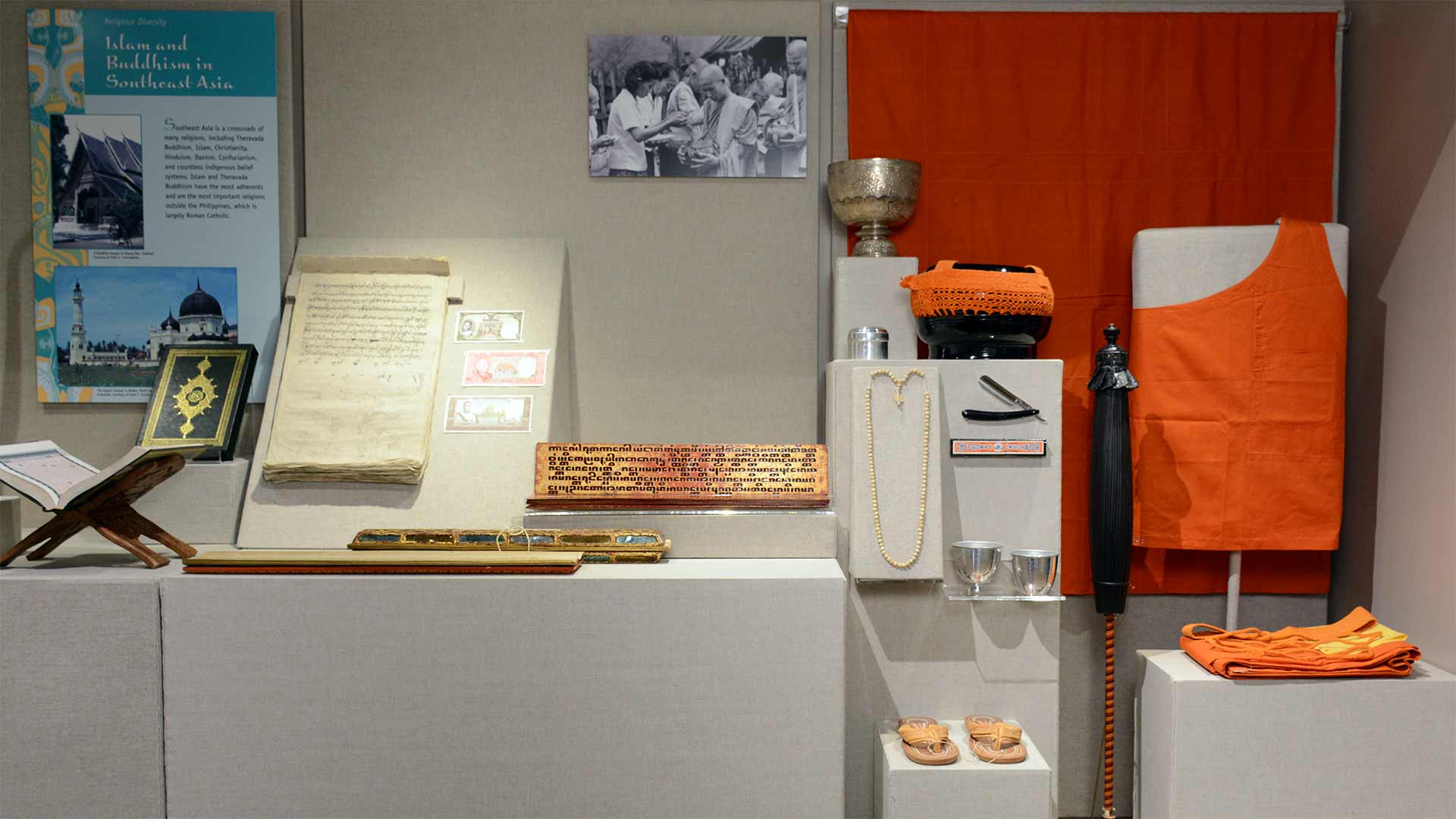 exhibit case photo with monk possessions