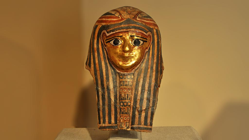 decorated mask with gold face