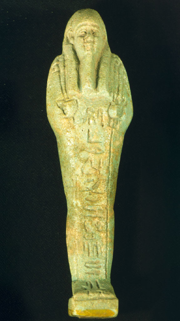 greenish stone carving of a mummy with hieroglyphics