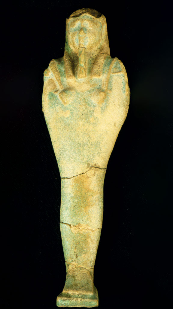 green and yellow stone carving of a mummy