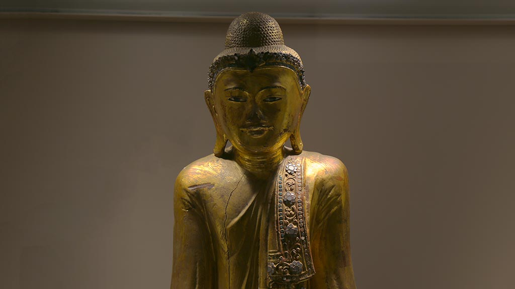 head and shoulders of a golden Buddha figure