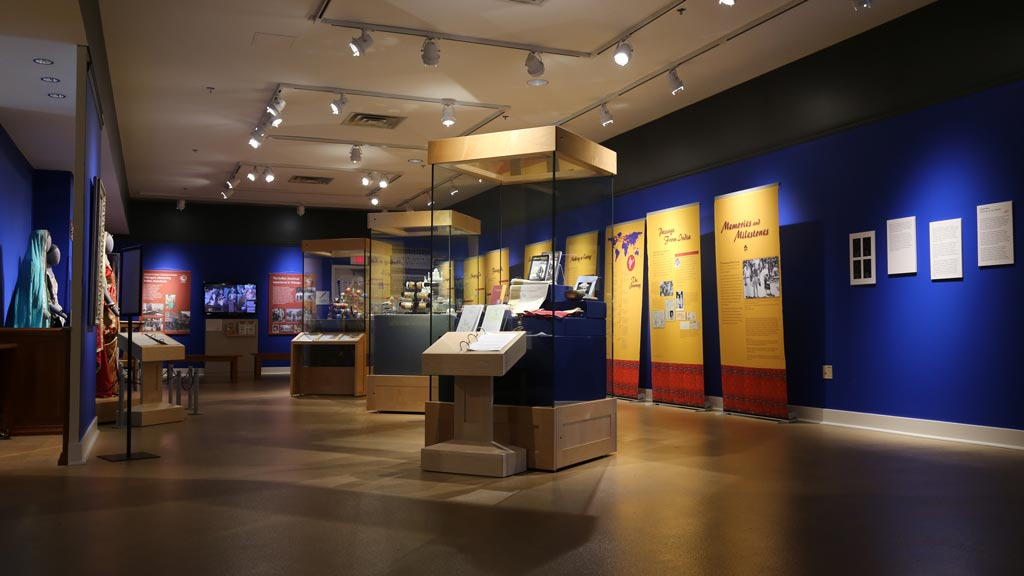 overview shot of the exhibit, showing cases, banners, and displays