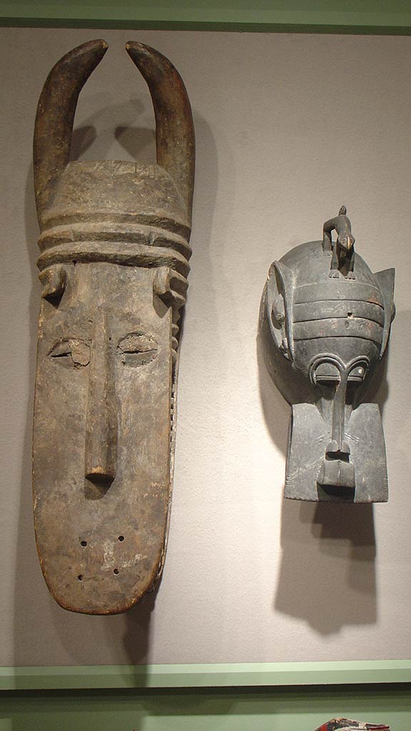 two wooden masks