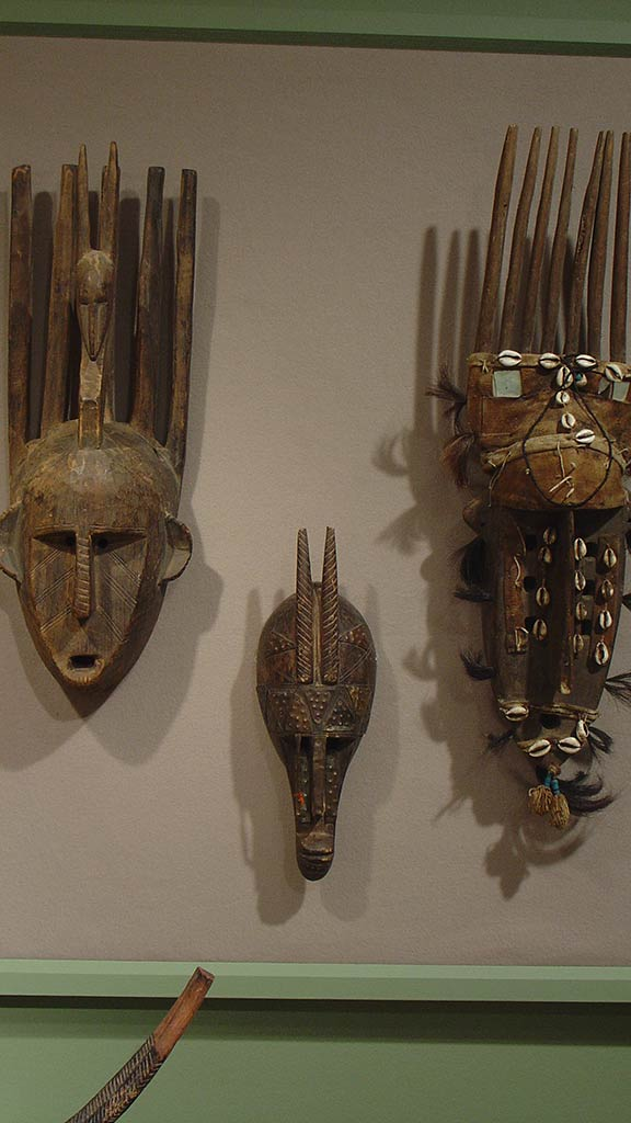 three wooden masks