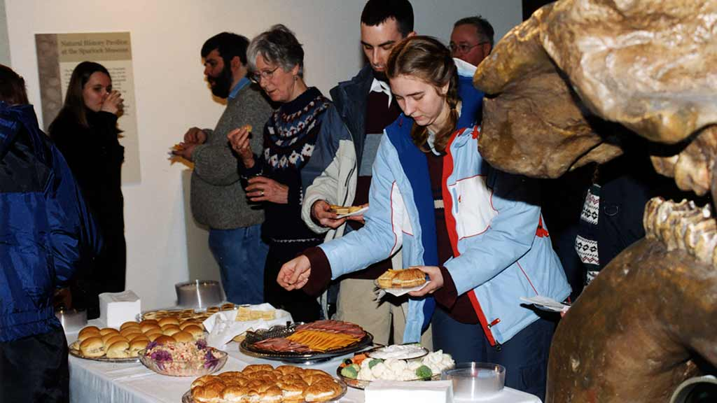 museum visitors enjoy a public reception with hor d'oeuvres