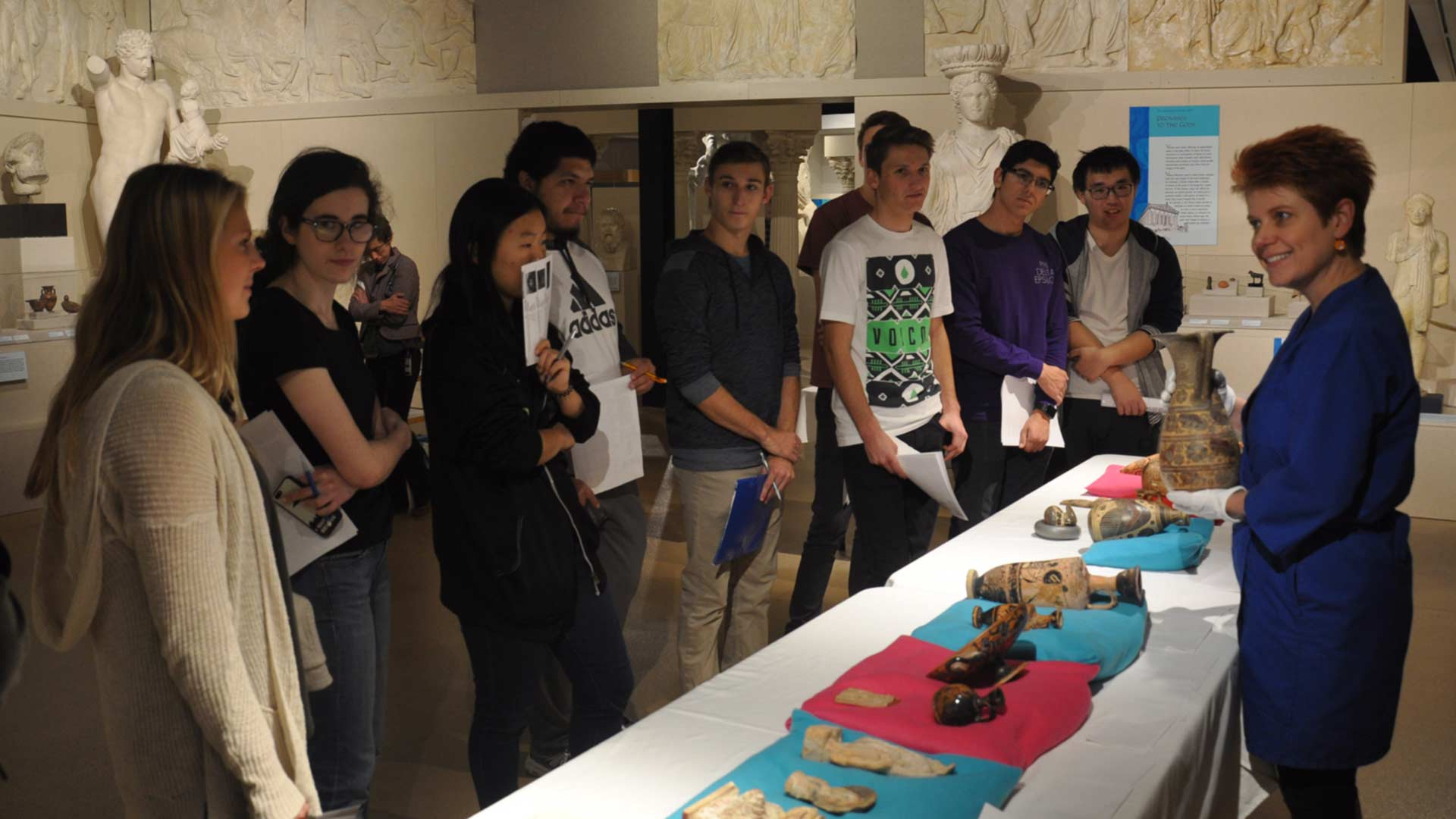 students in Ancient Med gallery reviewing objects led by a facilitator